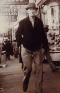 Mark Schieffelin walking on sidewalk with hat